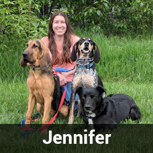 Jennifer with dog sitted on grass